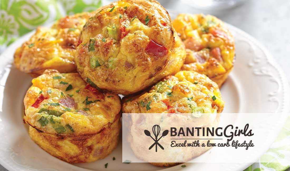 Egg muffins with cheese, vegetables and ham